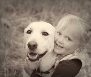 sepia of dog and little girl